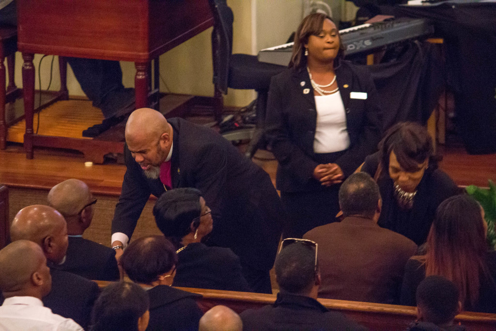 Bishop interacting with the family after a wonderful eulogy.