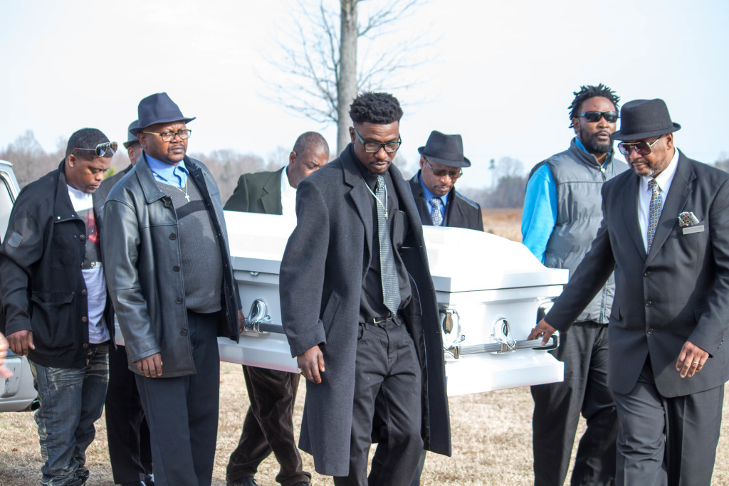 Pallbearers led by Deacon William Bynum carrying Mrs. Samuels to her final, earthly resting place.