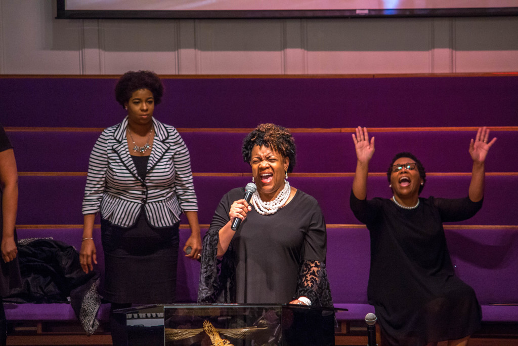 Sister K. Jenkins ministering through song to the family
