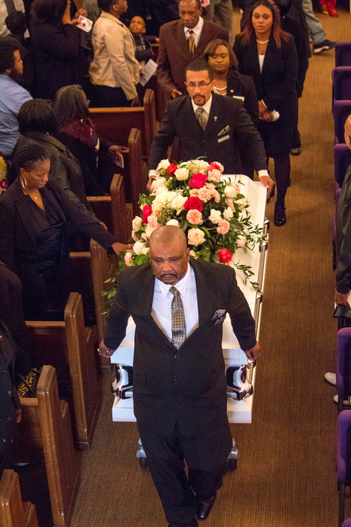 Deacon William Bynum and Joey Petway carrying the departed to their final natural place of rest.