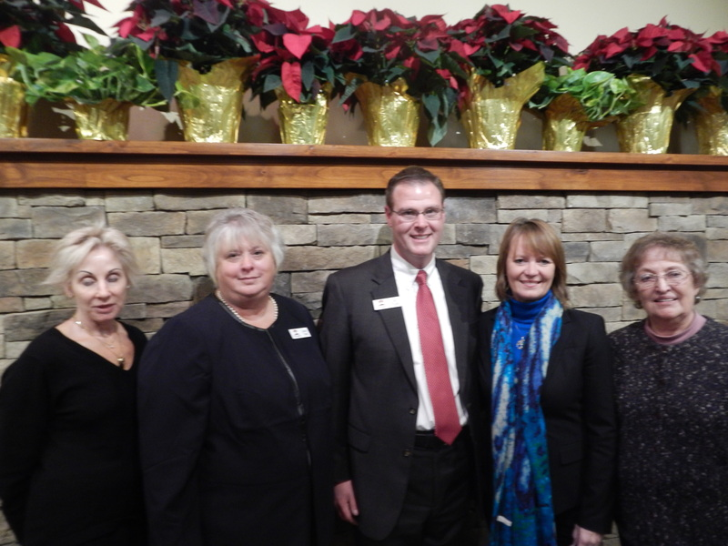 Eric O'Leary  Jeanne Yordi pose with PreNeed Systems and Homesteaders Life Company support staff during O'Leary Celebration of Life Center ribbon cutting November 2014