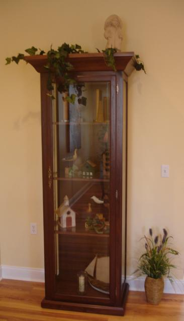 The hardwood used to make this cabinet was from the walnut casket in our selection room at the time of our fire in 2005