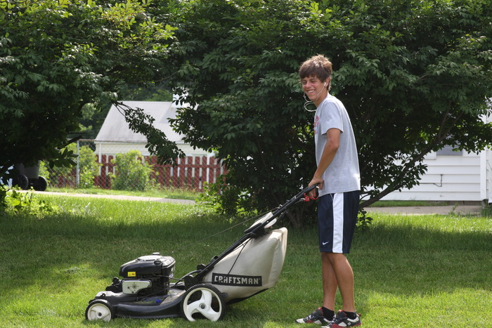 Landon...Kristi's son, mowing at Guisinger's