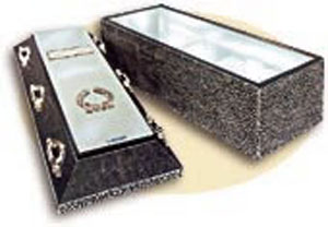 Regency: a concrete and polystyrene structure is enhanced by a gleaming mirror-finish 26 gauge stainless steel lining Featuring chrome plated casket style hardware and Name/Date plaque with religious or fraternal emblem. Butyl rubber compound bonds the base and cover into a single unit.
