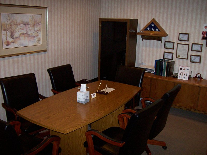 A private and distinguished arrangement office affords a comfortable setting to face challenging situations and make important decisions.