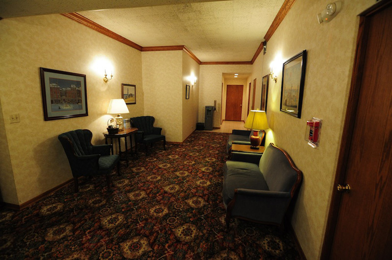 The upstairs lounge offers an intimate setting for relaxation or privacy.