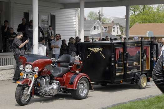 The hearse and bike together.