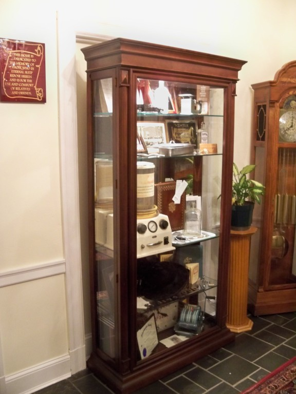 Curio with Swicegood's History Items