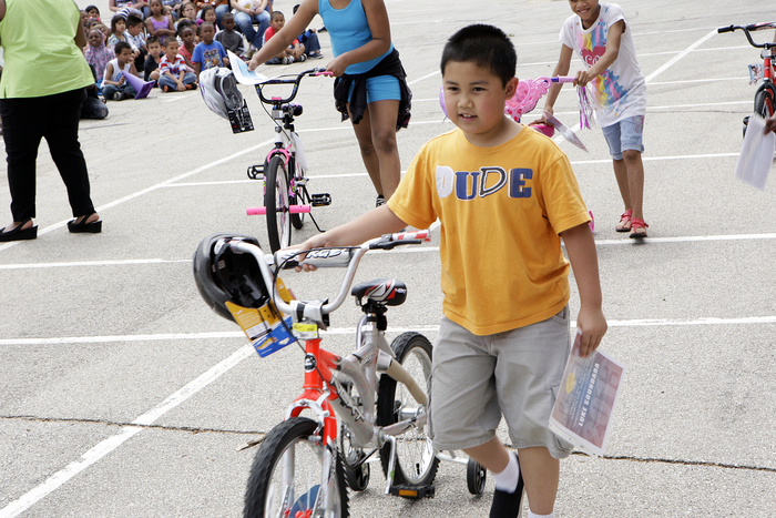 Thatcher's Funeral Home Celebrates Community with Grant Elementary School Bike Giveaway 2013