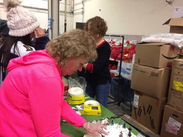 Carolyn Sparling volunteering at the Kanata Food Cupboard