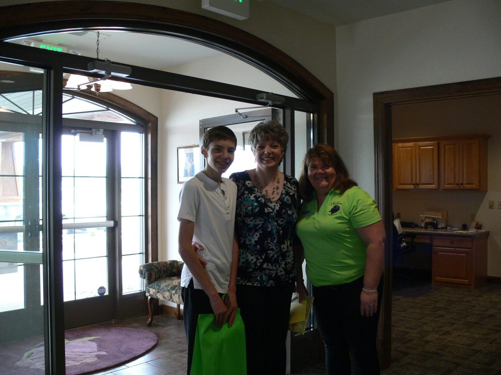 Kris Thelen with neighbors (Dr. Nicole and son) at the Open House