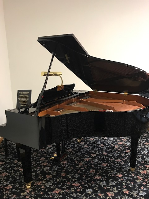 Baby Grand Piano in The Chapel - donated by Raymond Ernster