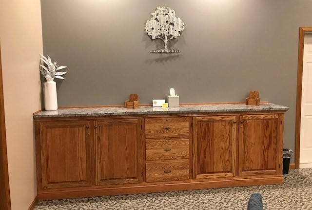 The custom-made counter with cupboards for register books, memorial folders, and a secured card drop.