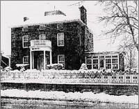 It was in the winter of 1953 that this photo was taken. The building, originally a wooden structure, was the office and residence of Dr. L.M. Halsey.