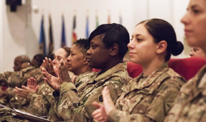 Military women clapping