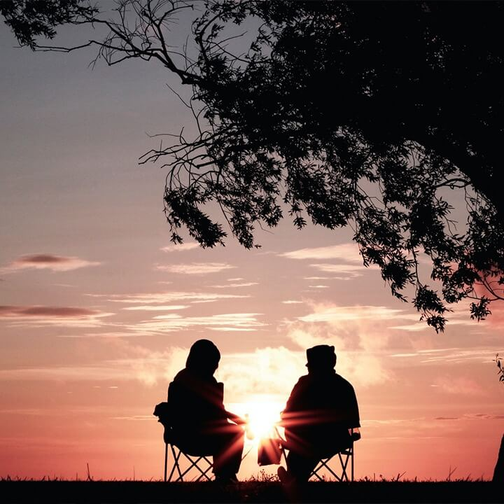 Couple watch sunset - How to Talk to Your Loved Ones About Preplanning