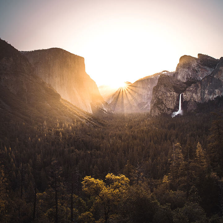 Sunburst peaking through the mountains - 10 Frequently Asked Questions About Cremation