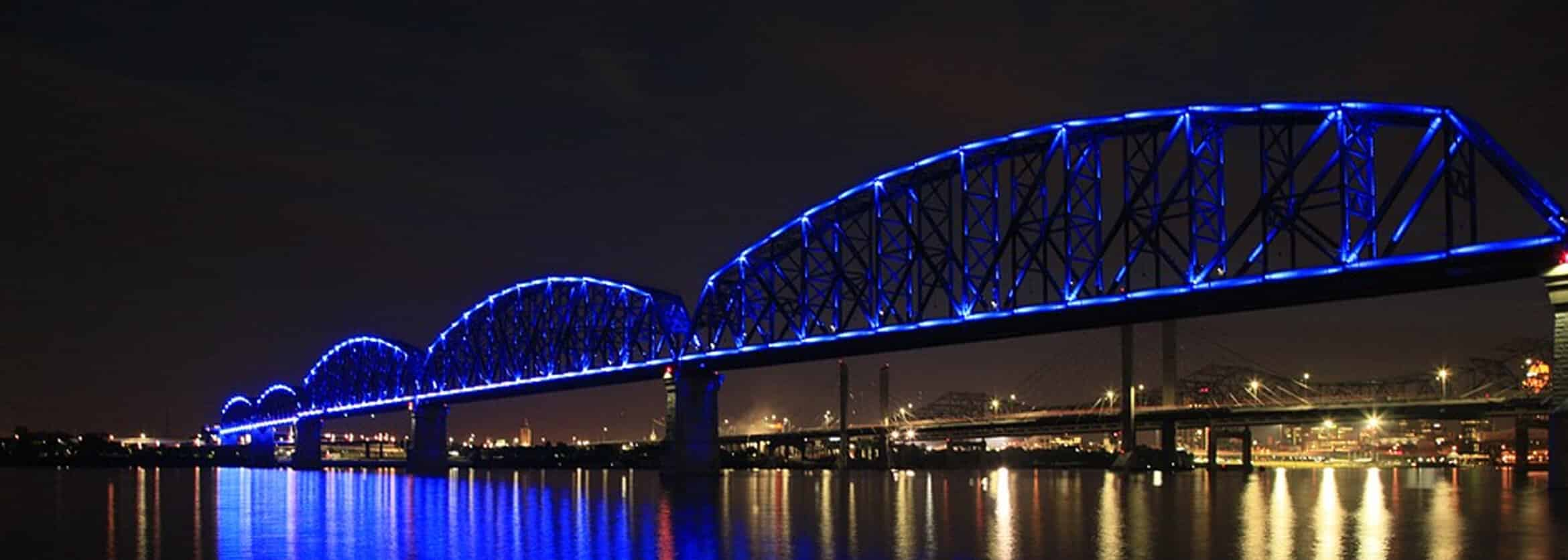 night time image of a bridge with blue lights