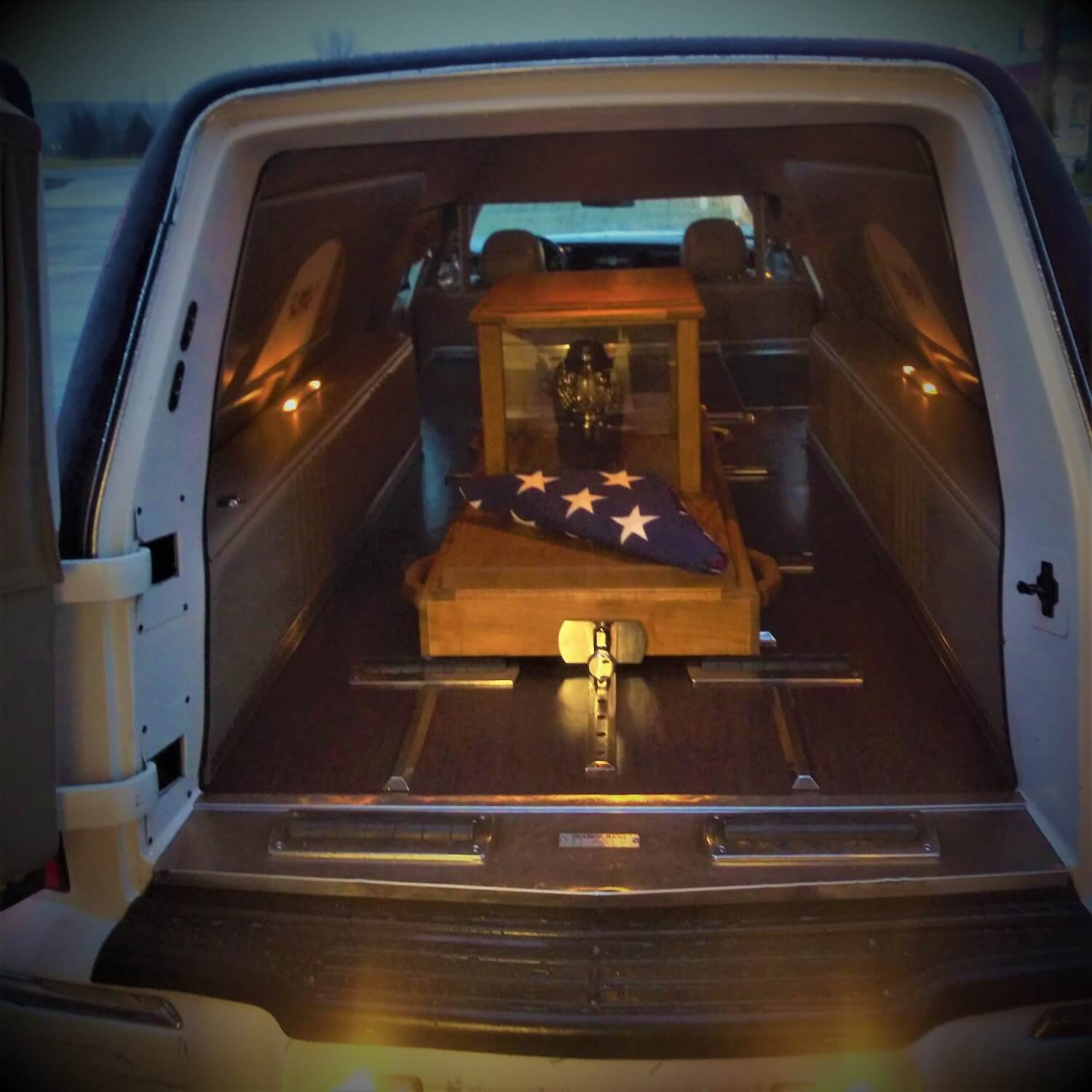 Image Depicting Our Urn Ark Being Transported In Our Funeral Coach