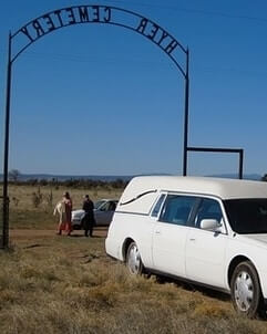 hearse transporting a funeral casket to a cemetery
