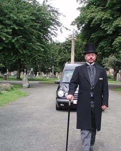 funeral director leading a funeral procession