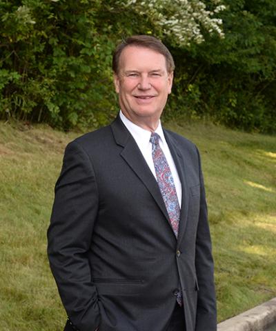 Douglas E. Mills