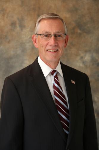John M. Confer