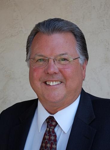 Greg E. Smith