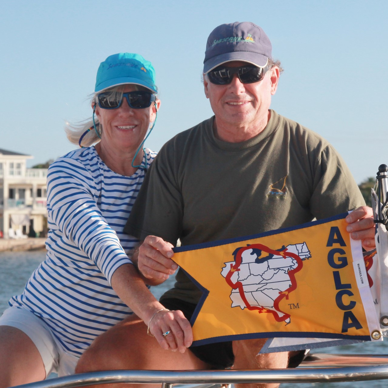 Couple Displaying Gold Burgee
