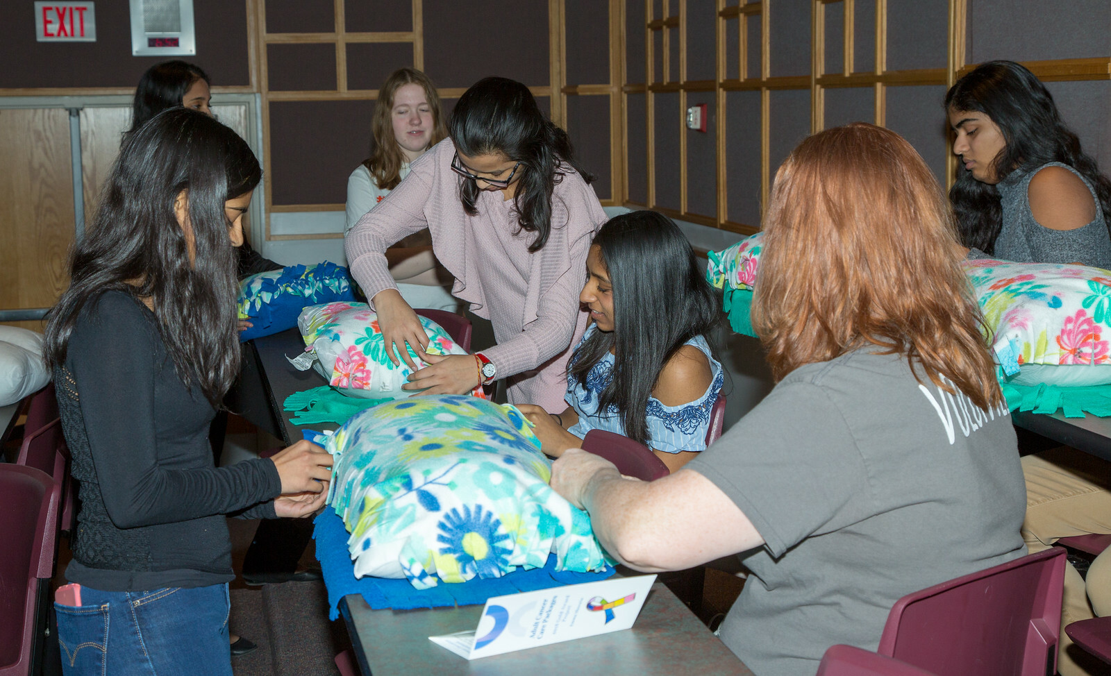 Neuqua Valley High School Interact students assemble pillows for the Rush Copley Cancer Care Institu