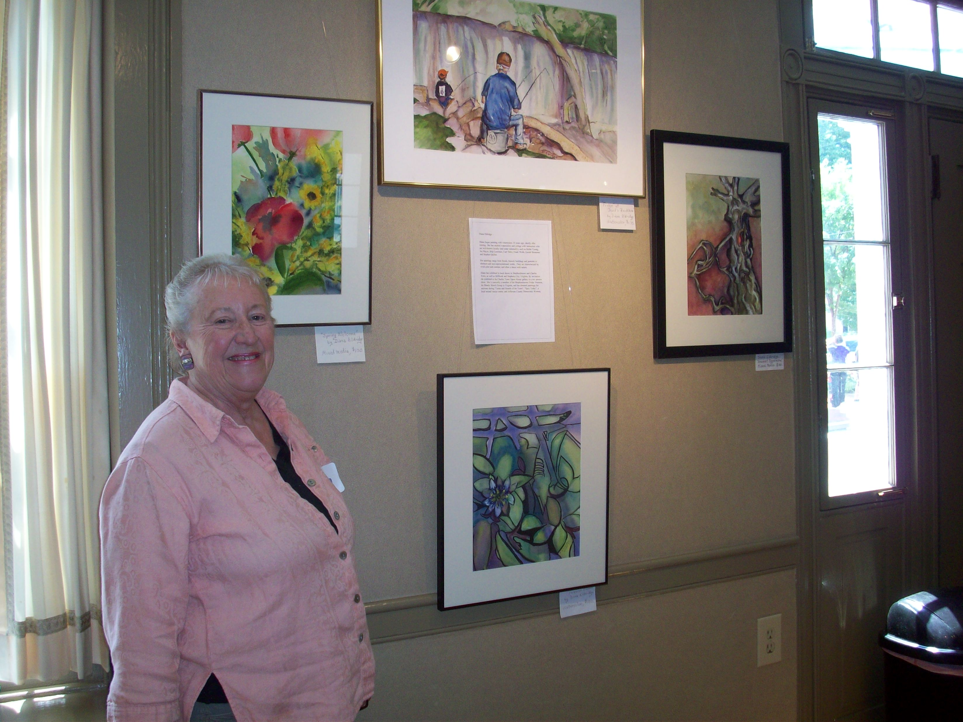 Diana Eldridge in front of her paintings