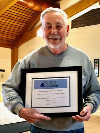 Tom Miller accepting SAILs Community Service which was awarded to Trinity Episcopal Church and GT