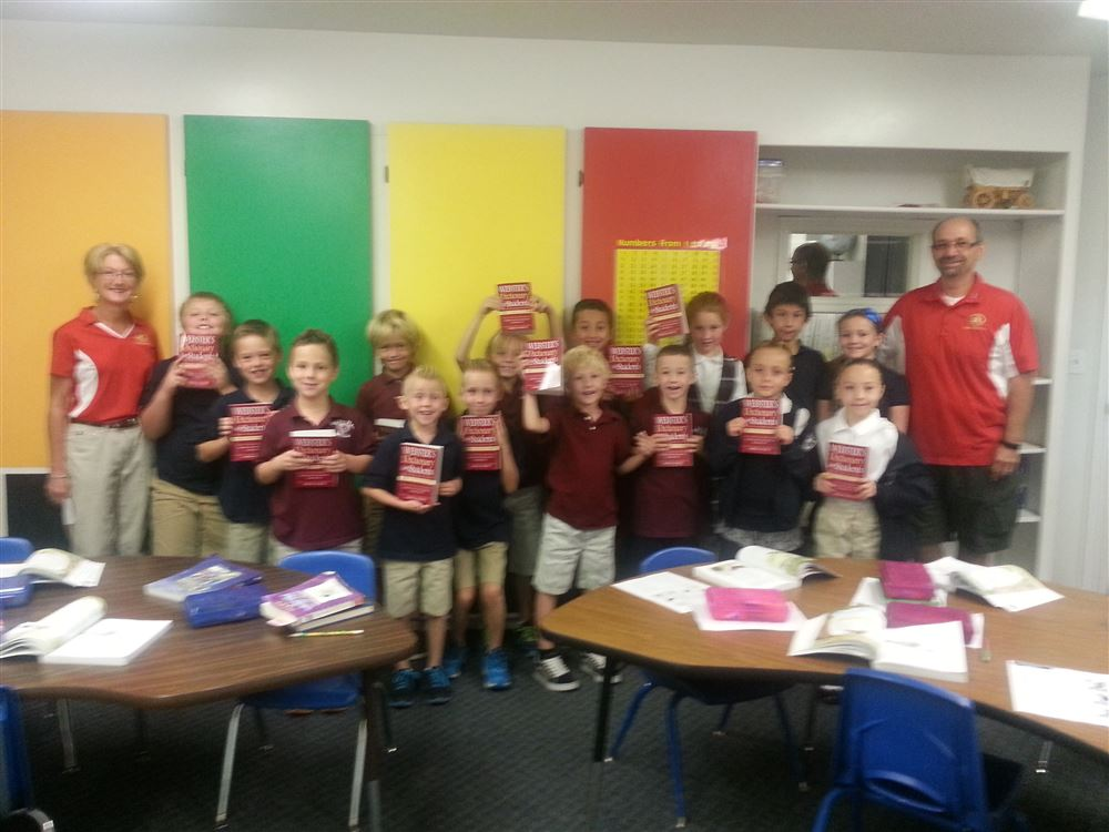 Pictures showing Red Rock Rotary members distributing dictionaries to 3rd graders in Washington County Schools.  Red Rock Rotary does this every year.