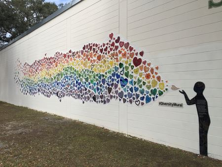 AMG members contributed to this project in Orlando, FL. It was created to honor the memory of the lives lost in the tragic shooting at Pulse Nightclub. Facebook: Diversity Mural Project in Orlando