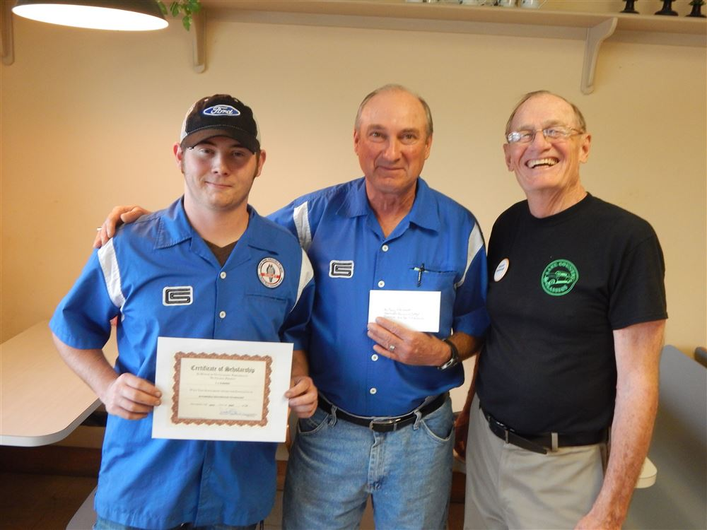Left to Right Scholarship winner T.J. Eubanks, Tony Whitworth, automotive instructor and Darrell Slabaugh, club president