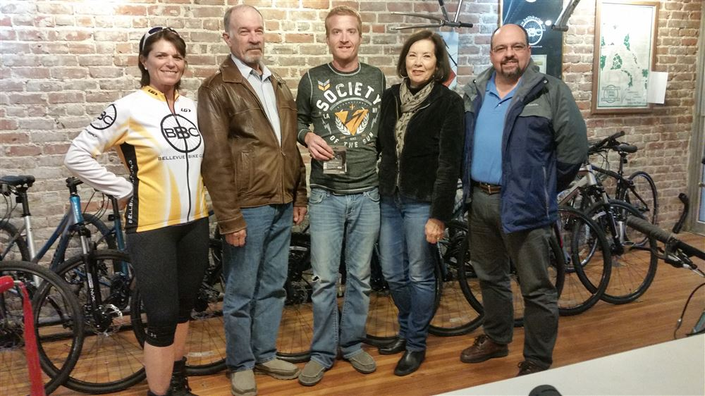 Steve being presented a gift card from the BBC in appreciation for donating a bicycle for the Spoke and Hub Raffle