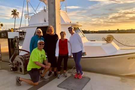 NWC walkers on the Naples City Dock as the sun rises on 2-24-20