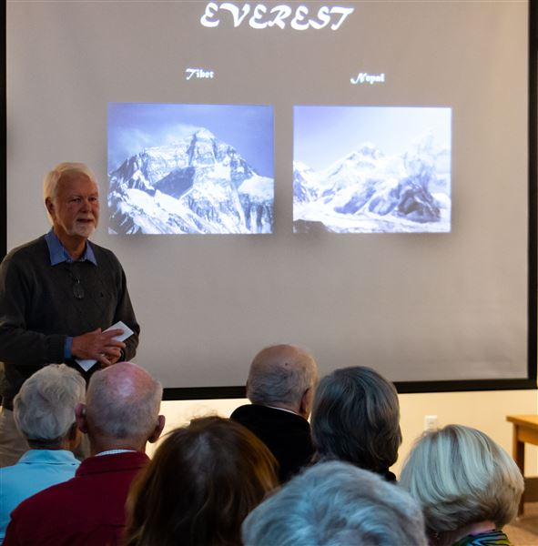 Photos of a rapt audience hearing about summiting Mount Everest by Craig John