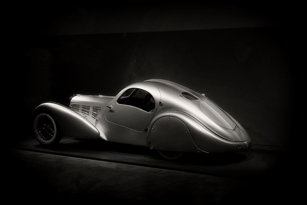 A black and white photo of a 1935 Bugatti