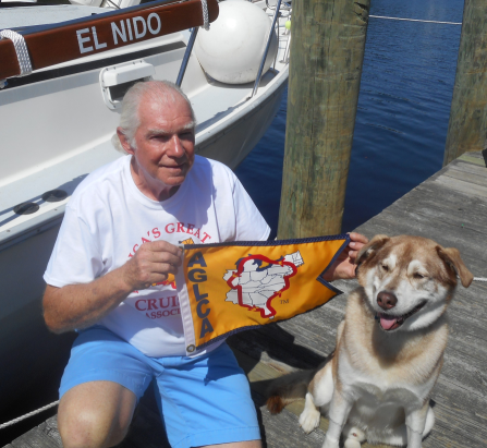 Bob Frederick With His Dog and Gold Burgee