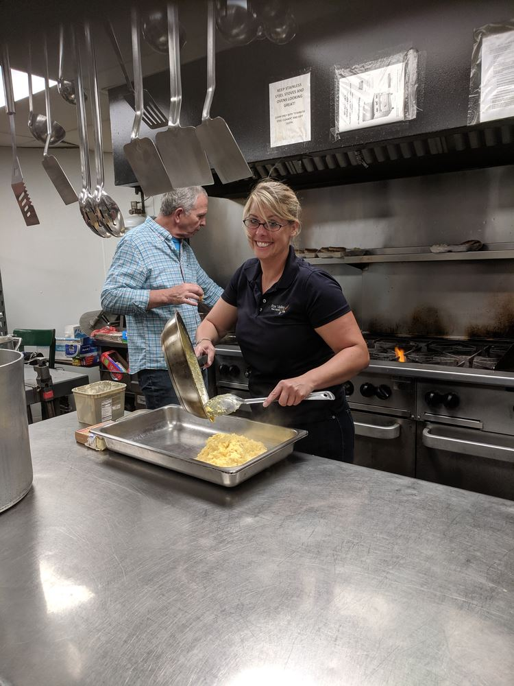 Hessed House Breakfast volunteers Charlie Zine and Krista Mulready cooking up some scrambled eggs! Other Rotarians included Bruce Darata, Linda Kemp and Mike Drews