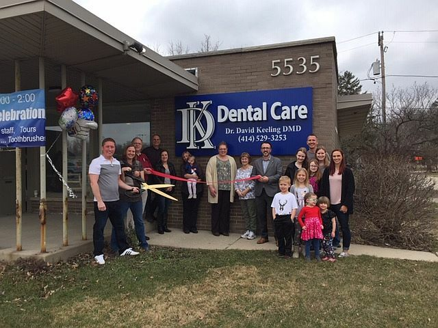 DK Dental Care cuts the ribbon to open their new buiding