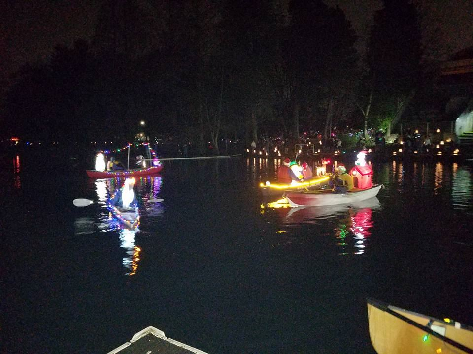 Parade of lighted Xmas Canoes