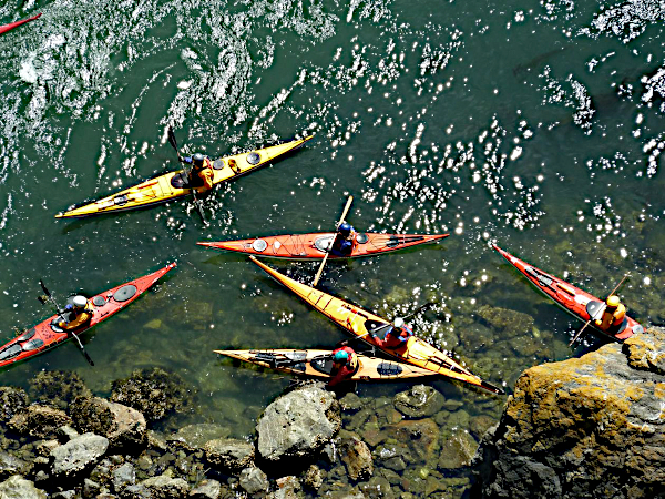 kayakers gathered along shore of Deception Pass