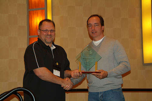 Matt Richardson being presented with the IT Professional of the year by Rob Petty, former Mi-GMIS President