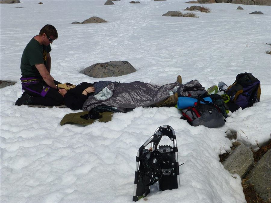 A snowshoer tripped and sprained her ankle at Lake Winnemucca, close to where we were camped. The leader of the group of first-time snowshoers asked us for assistance, unaware of his good fortune.