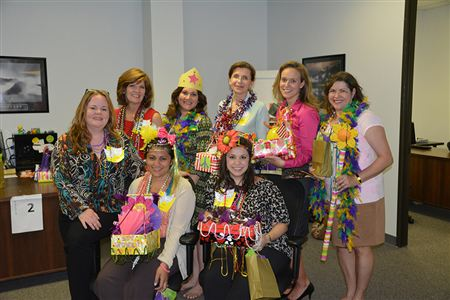 We welcomed new members with a festive Mardi Gras theme. Party guests design floats based on the new member in their group and a fabulous parade was held!