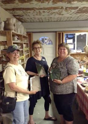 Members enjoyed glazing their own pottery at Foelber Pottery.