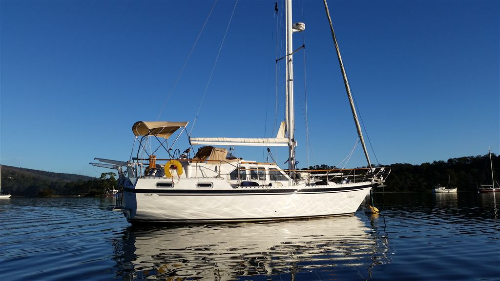 Tim and Jill McCabe and their photos aboard Suhail, a Nauticat 35 deck saloon pilot house sloop based in Hobart.