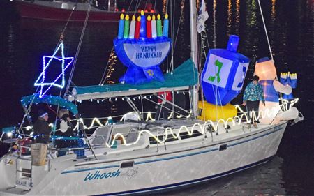 "For the 2018 Deale Lighted Boat Parade,WHOOSH was decorated by ""Schmelves"" (Hanukkah Elves!"" Dale, Janet, Andrea, Stefan, and Jeremy and crewed by Andrea, Stefan, Cathy, Gail, Donna, and Jeremy."